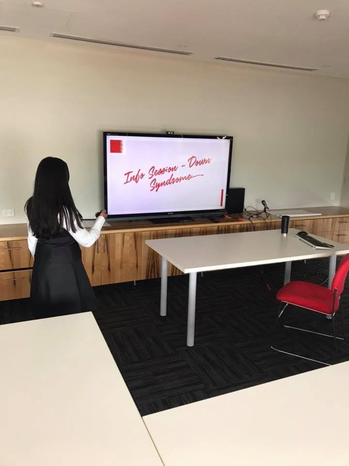 Woman pointing at screen, presenting