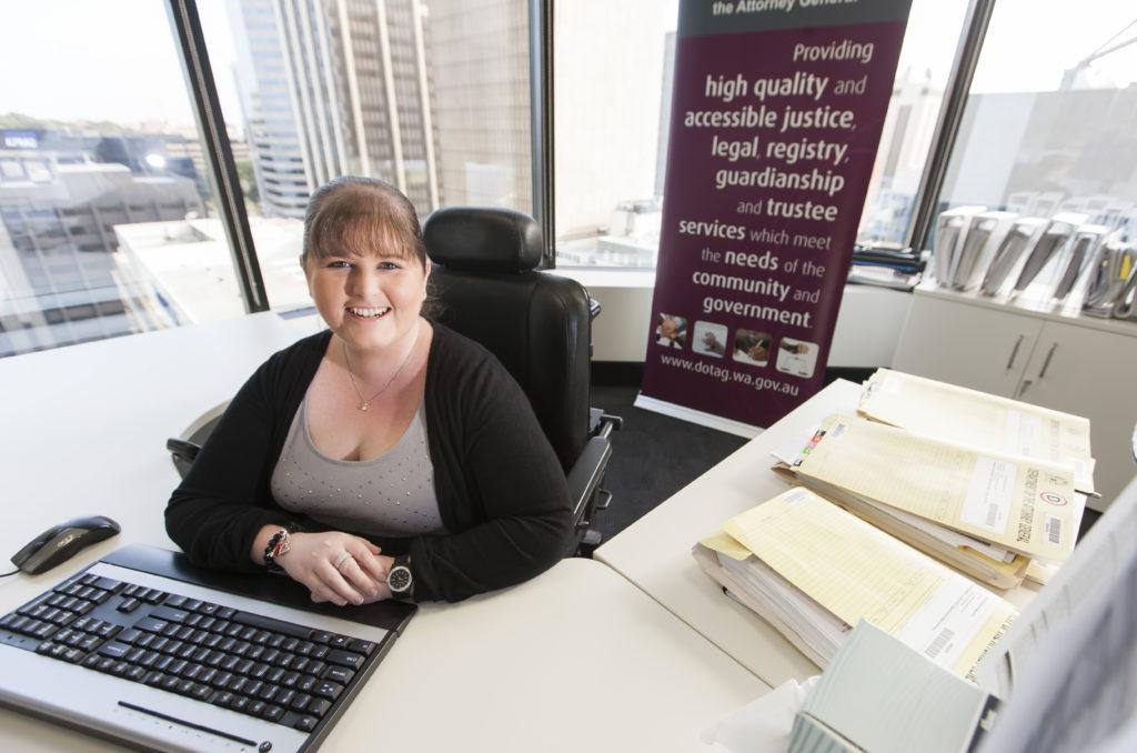 Deanna sitting at her desk