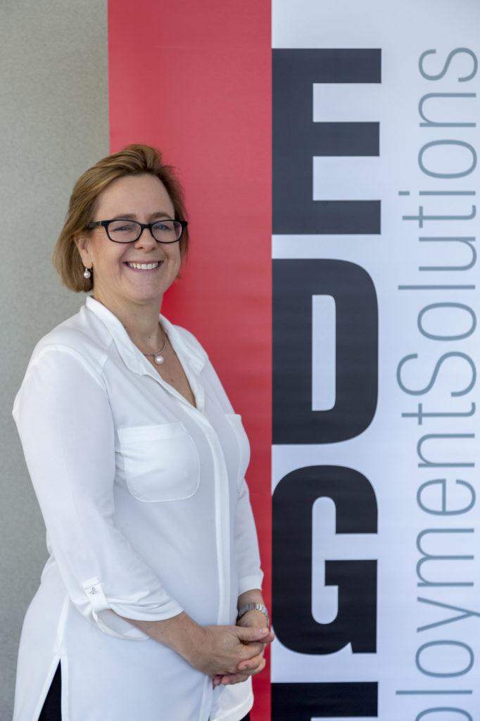 Jennifer smiling in front of Edge banner