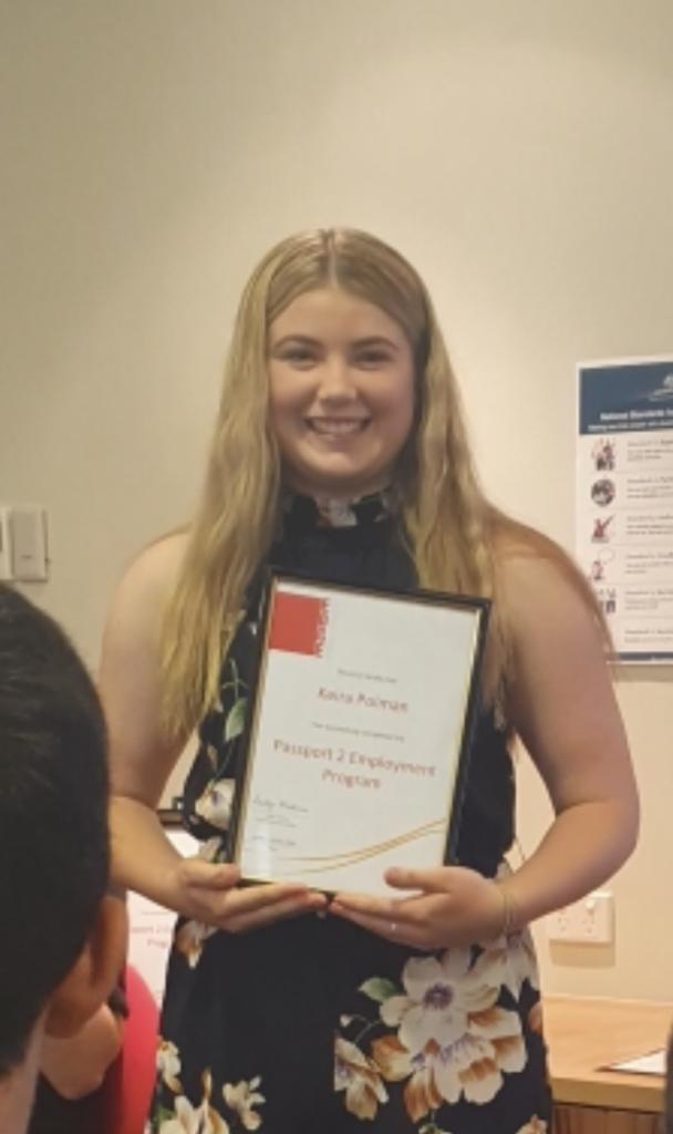Kiera holding her certificate