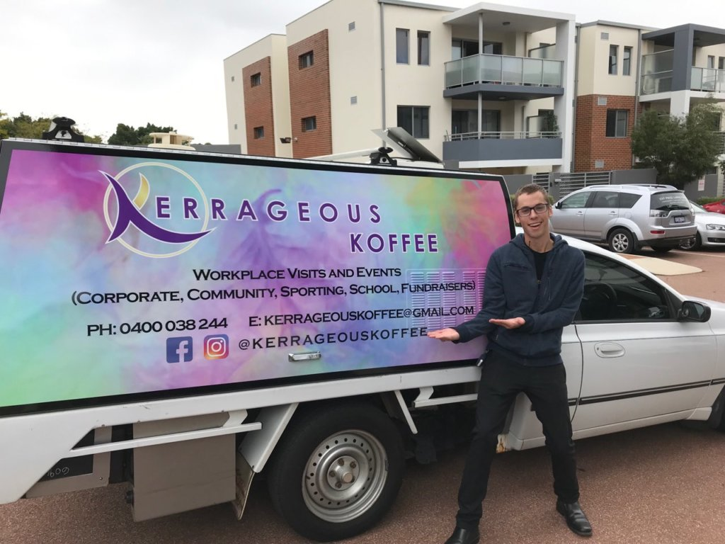 Leighton pointing to the signage on the company vehicle
