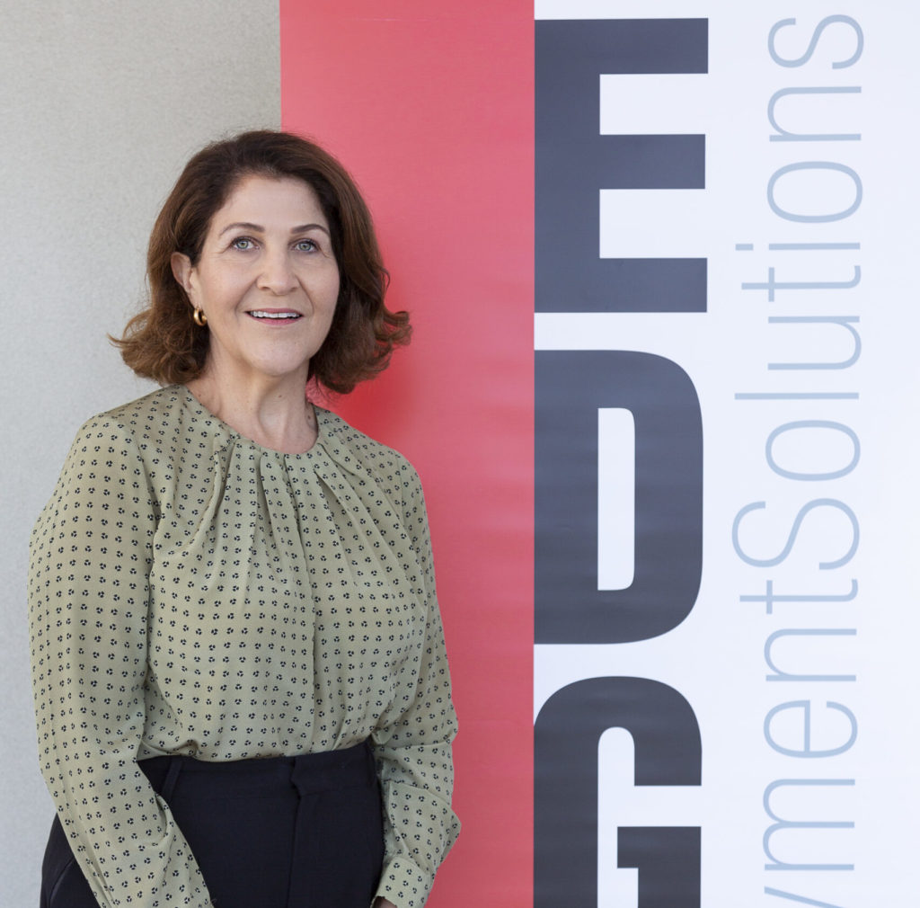 Linda smiling in front of Edge banner