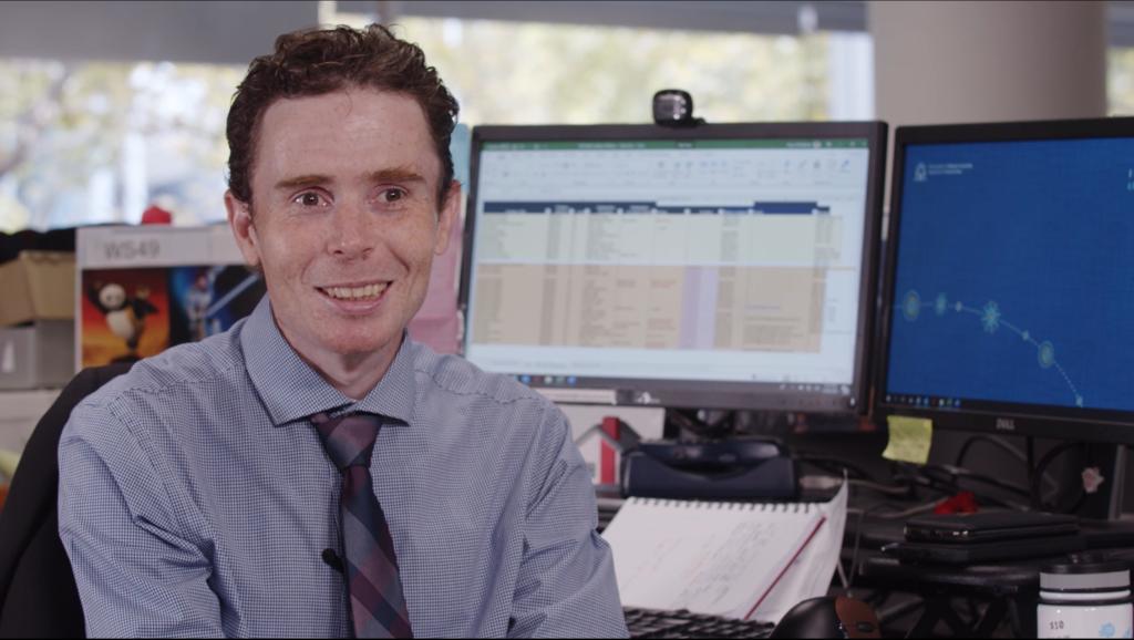 Peter smiling at his desk